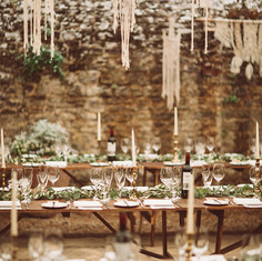 Macrame decorations at Bignor Park Wedding, long white candles, greenry table centres