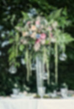 tall, rustic, organic table centre, with garden roses, hanging glass baubles,