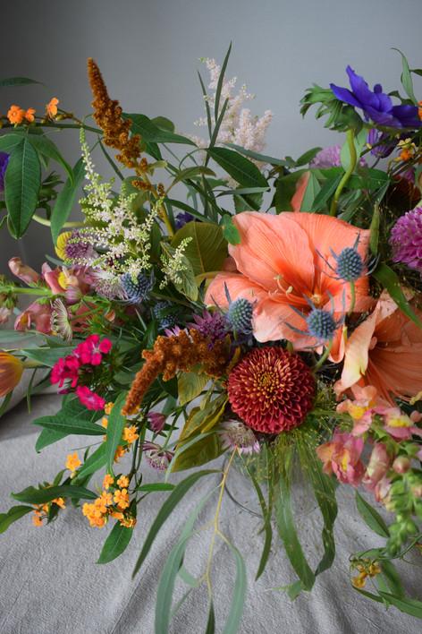 Wedding Wildflower Centrepiece with Orange Amaryllis Flower and Orange Tulips