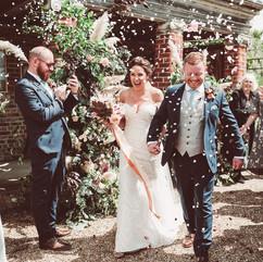 Outdoor ceremony florals at Bignor Park , West Sussex