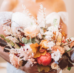 peachy and caramel wedding bouquet with peony and heuchera