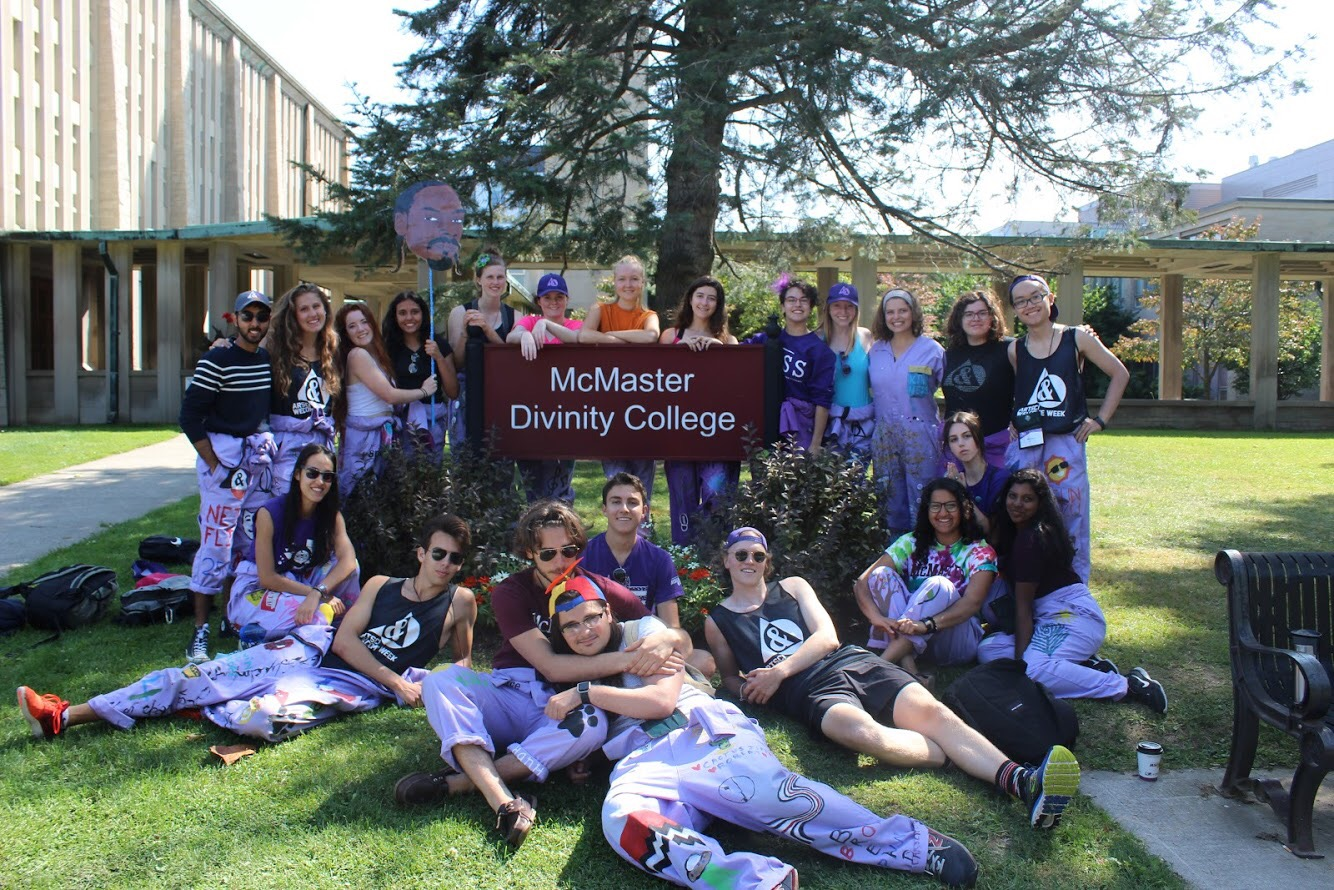 group of students around sign purple