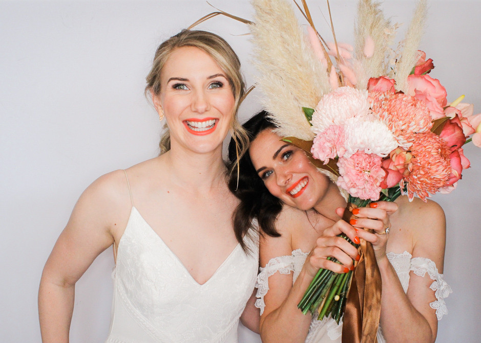 Two brides using a photo booth in Adelaide