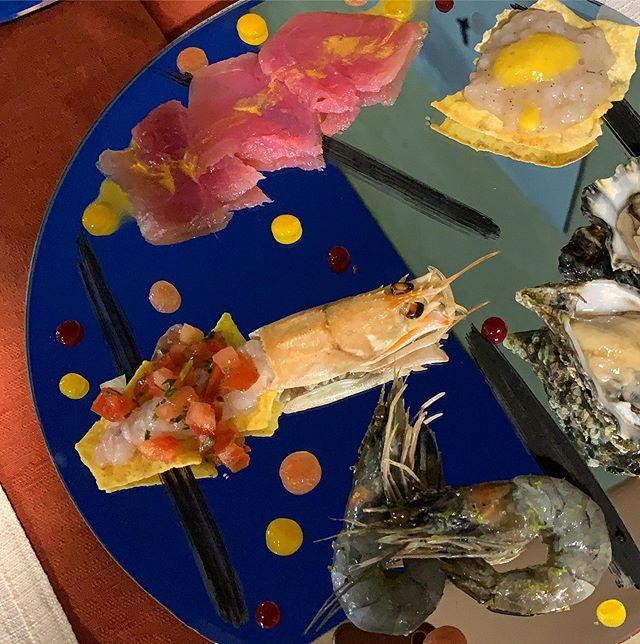 Fish crudo: tuna and gold, calamari and mango, langoustine and pico de gallo, blue shrimps, oyster