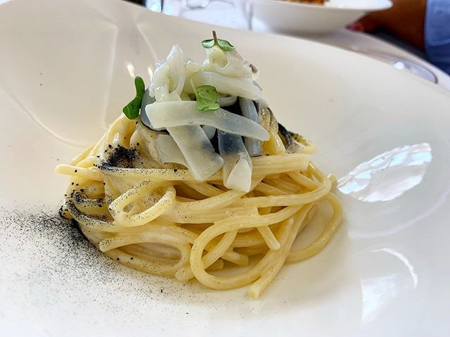 Spaghetto bianco e nero seppia: squid cream, squid ink fresh and dehydrated, squid julienne