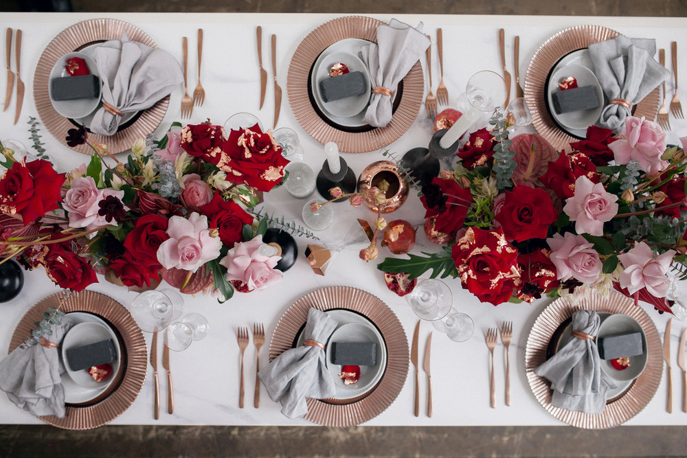 Gorgeous rose gold and burgundy wedding table decor