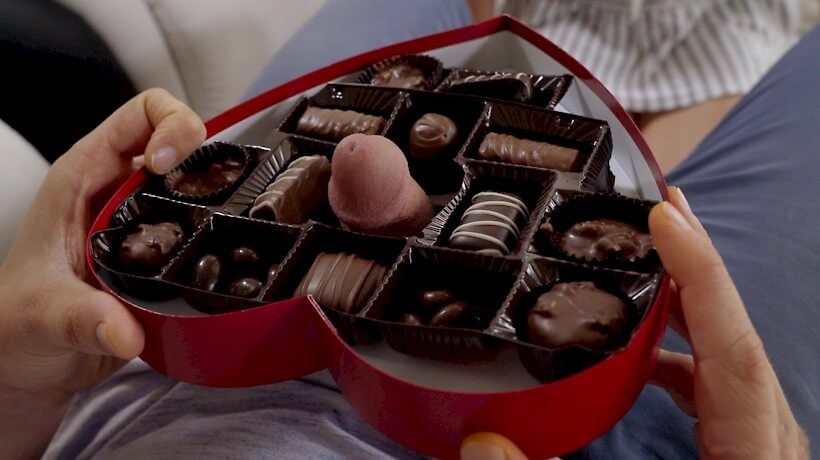 Man showing penis in chocolate box