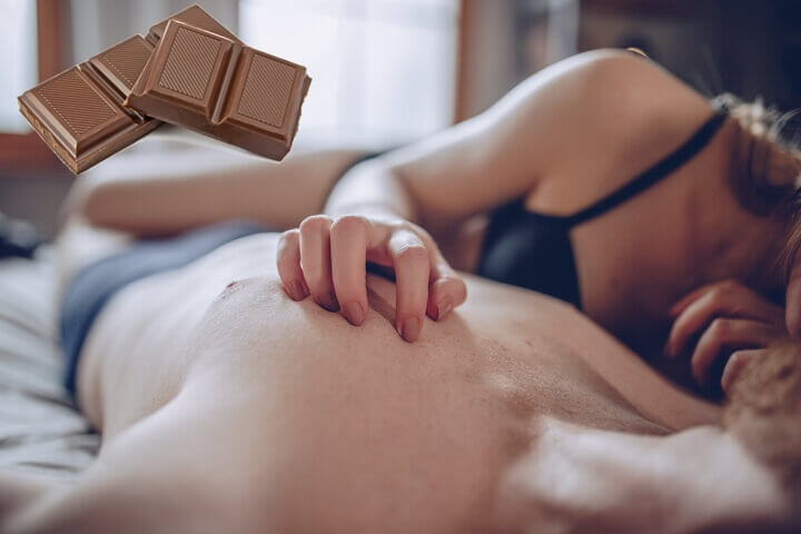 Couple having sex with chocolate