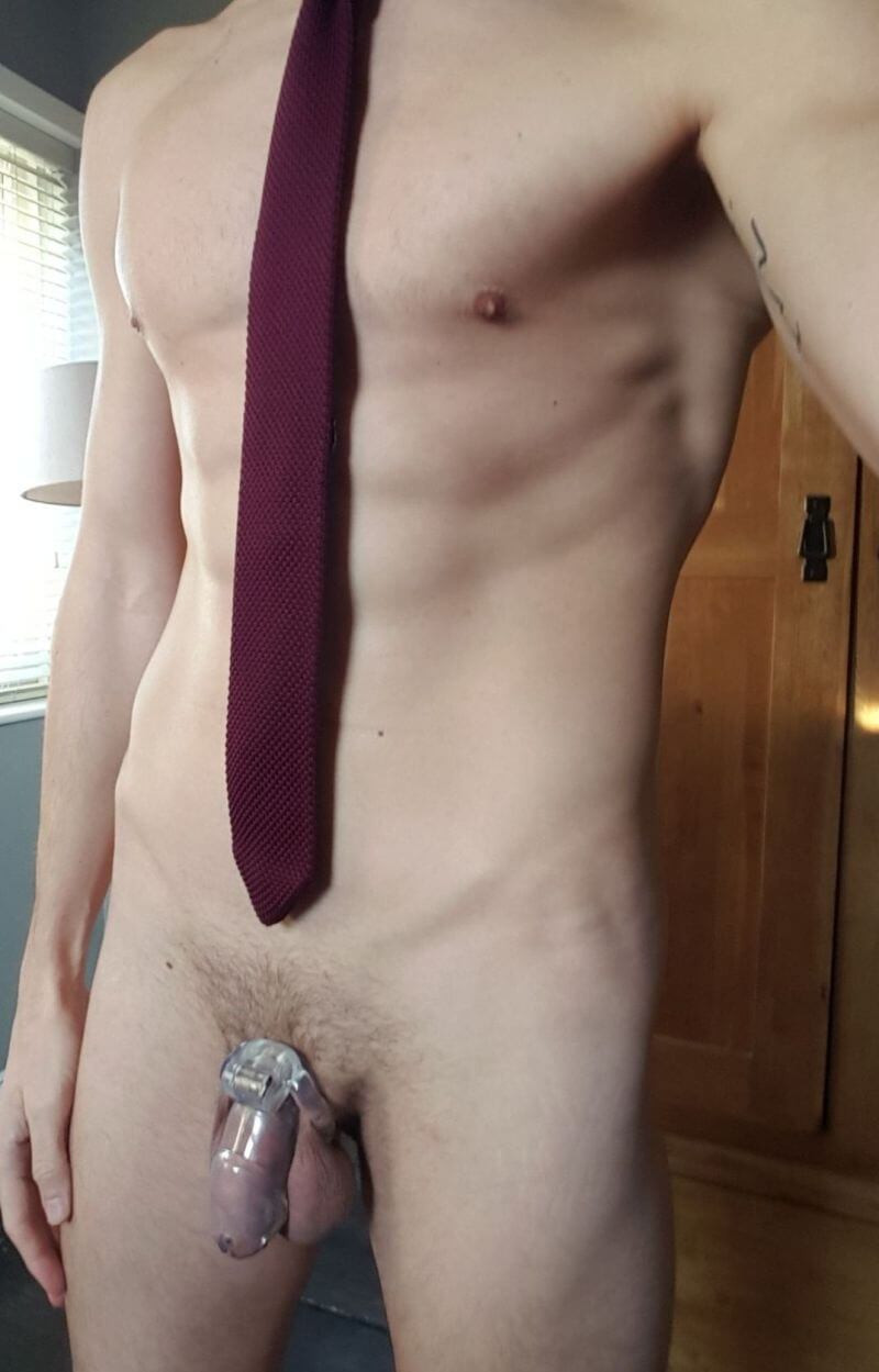 Man in office wearing transparent cock cage