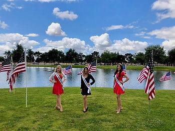 titleholders with flags.jpg