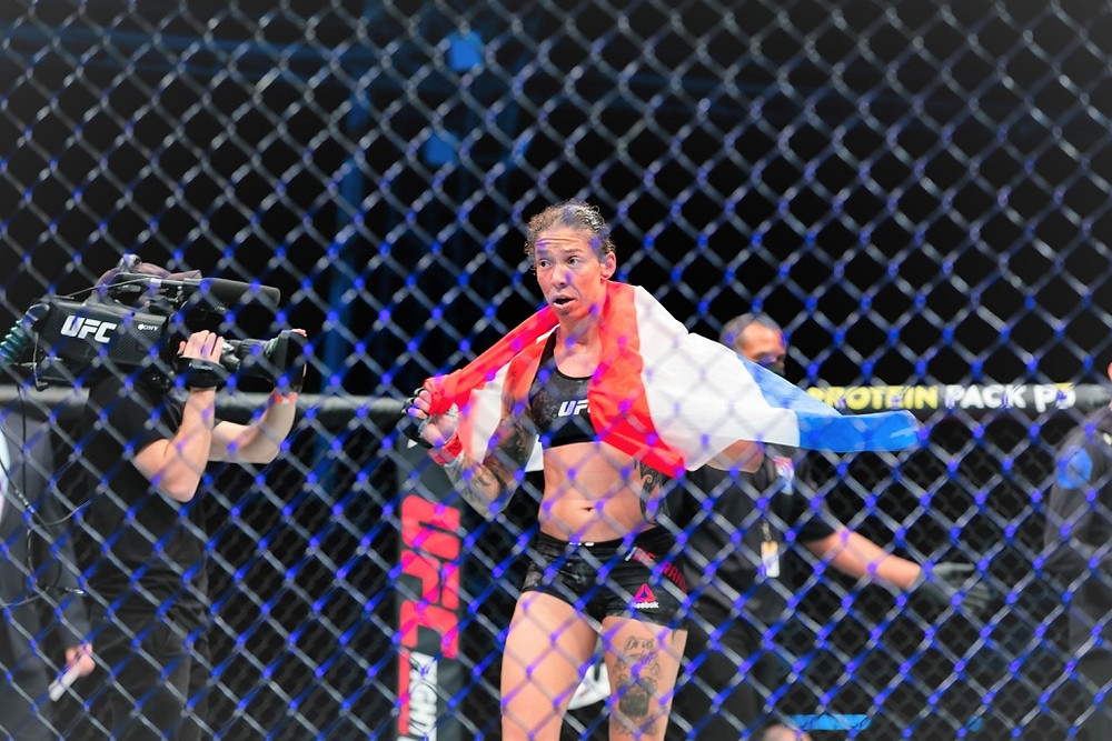 Germaine de Randamie celebrates her victory over Julianna Pena in the third fight on the main card