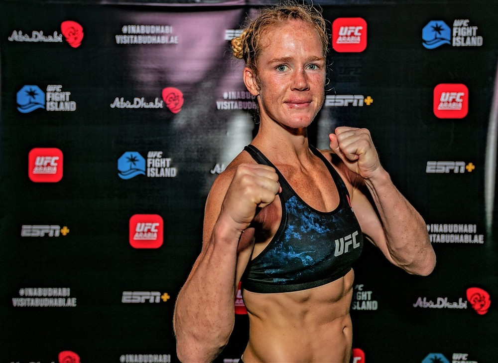 Holly Holm celebrates her victory