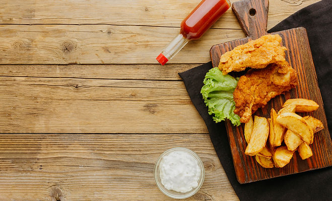 top-view-fish-chips-with-ketchup-bottle-