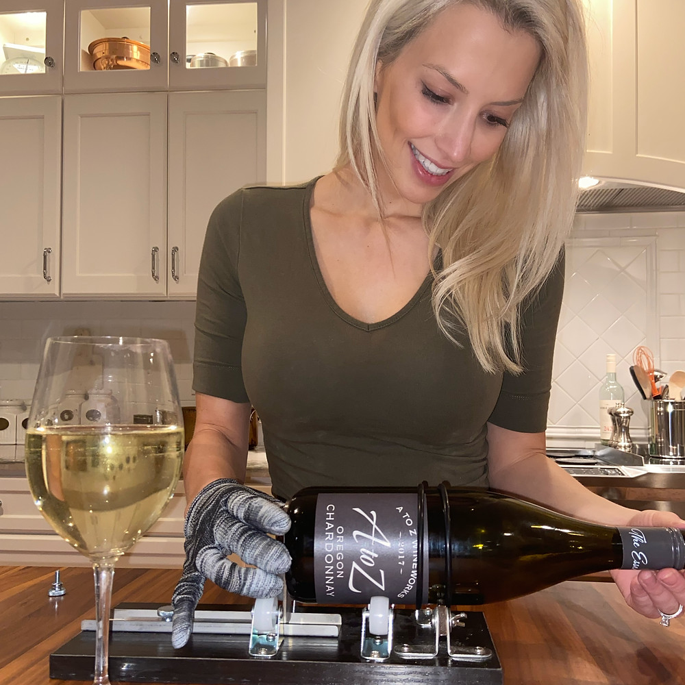 Here I am using a glass cutter to cut a bottle of wine to make at home wine candles!