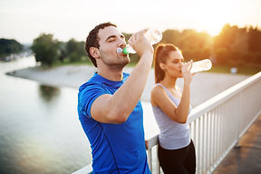 Couple staying hydrated after workout.jp