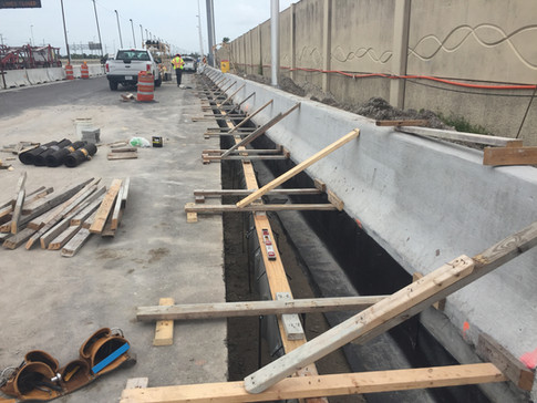 Trench drain system at Jersey Barrier