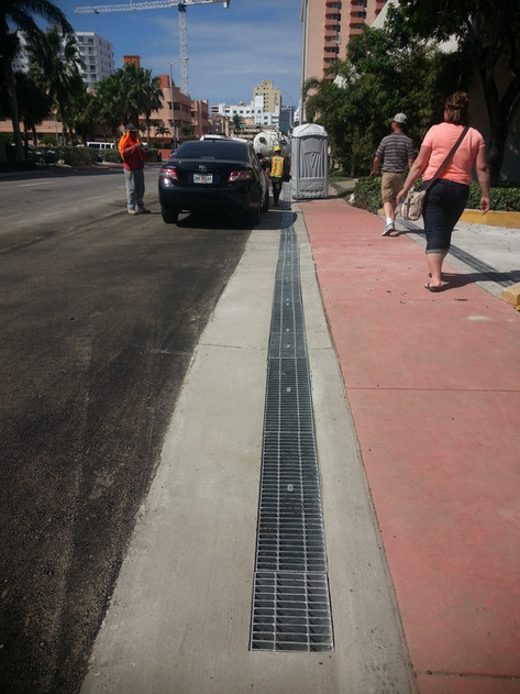 Curb and gutter trench drain