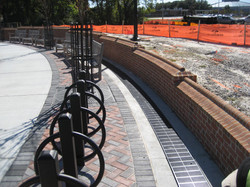 Curved trench drain at park retaining wall
