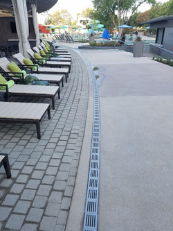 Radius trench drain on pool deck