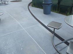 Patio radius trench drain