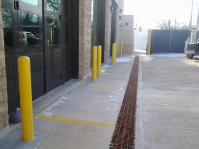 4 corner bolt down trench grates at fire station