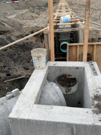 trench drain outle pipe connecting to structure