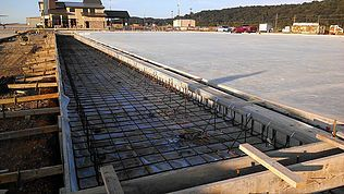 Private aircraft hangar trench drain system