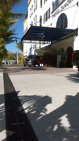 Hotel driveway entrance trench drain system