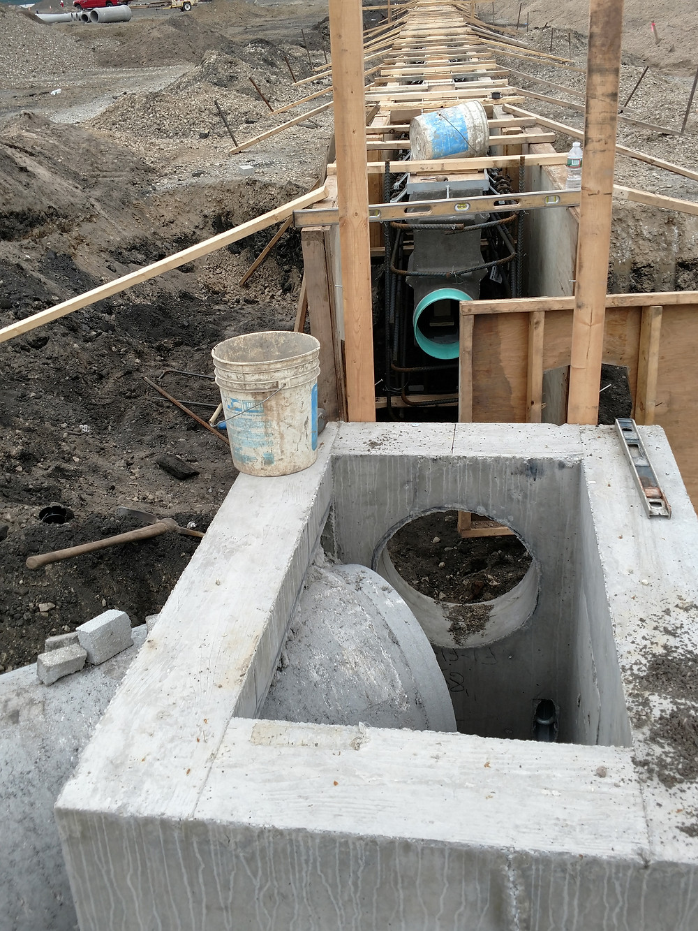 Trench drain connection to structure with pipe