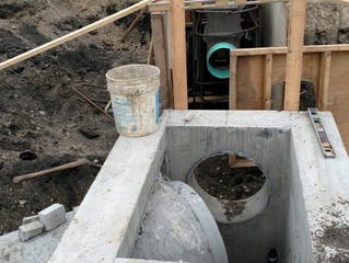Connecting a trench drain to a concrete manhole structure