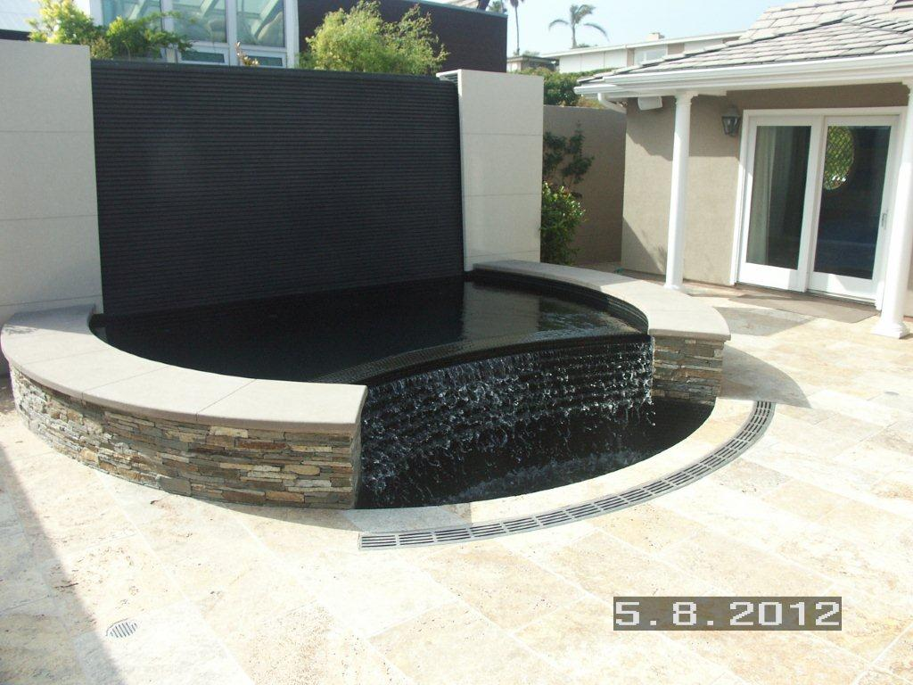 Water feature radius trench drain
