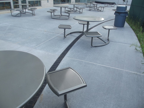 Patio seating area with radius trench drain