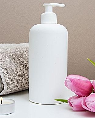 white%20plastic%20pump%20bottle%20beside