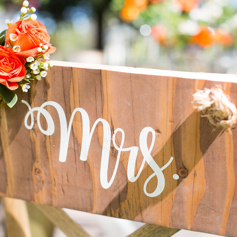 """MR. & MRS. SIGNS  Our newlyweds signs are the perfect mix of rustic and romantic.     Add these finishing touches to the backs of your sweetheart chairs.  Dimensions: 8"""" x 13""""  Qty: 1 set"""