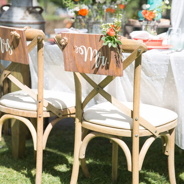 """MR. & MRS. SIGNS  Our newlyweds signs are the perfect mix of rustic and romantic.     Add these finishing touches to the backs of your sweetheart chairs.  Dimensions: 8"""" x 13""""  Qty: 1 set."""
