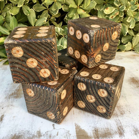 """GIANT YARDTZEE  Our Giant Yardtzee is so much fun. The """"dice"""" are made of 4 x 4s and numbered appropriately.  Comes with:  5 dice A blue plastic bucket Yardtzee score-keeping pages"""