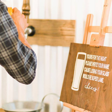 """FULL BAR  Our rustic Barisbuilt from reclaimed wood. It's a guaranteedcrowd-pleaser at any wedding or event.  Features two walls with separate serving stations:  Bar #1: Is a self-serving station w/Taps installed. Bar #2: Issimilar w/outTaps.  Dimensions: 72"""" x 72""""     Qty: 1 full bar  - Does not include bar lights, canoe or drinks -"""