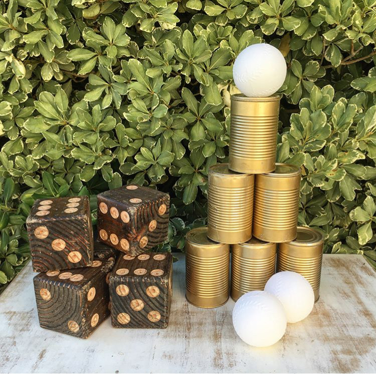 CAN TOSS  Keep your guests entertained during the Cocktail hour. Can toss is always a crowd pleaser!  Comes with:  10 cans 3 balls  (Contact us for a custom set)