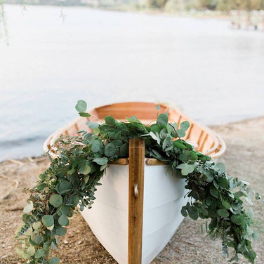 """ROWBOAT  This is our romantic, white rowboat inspired by: The Notebook.  It washandcrafted out of whiteoak, mahogany, marine-grade plywood and topped off with brass oar locksand fittings. The oars are madeof douglas fir.  Rent this beauty for engagement photos, wedding photos or a day out to the lake.  Dimensions: 48"""" x 174""""  Qty: 1"""