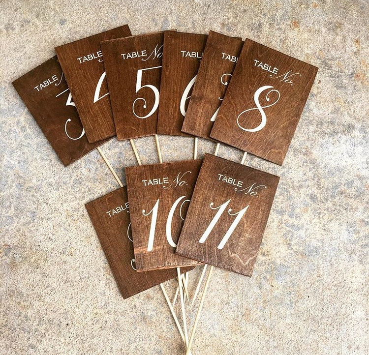 """RUSTIC TABLE NUMBERS  These table numbers are made of plywood, stained a dark walnutand painted using a vinyl stencil.  Dimensions: 12""""  Qty: 1-14"""