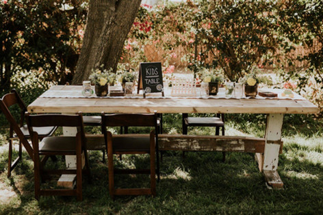 "FARMHOUSE TRESTLE TABLES  Our rustic Trestle Tables are built from reclaimed wood.  No single table is alike.  They're ""imperfectly perfect"" for any occasion.  Dimensions: 96"" x 36 x 31""   Seats 6 - 10 guests       Qty: 14"
