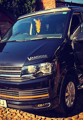 Black and orange VW t6 campervan