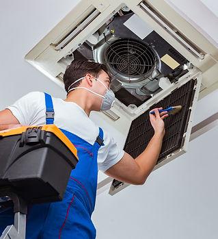 worker-repairing-ceiling-air-conditionin