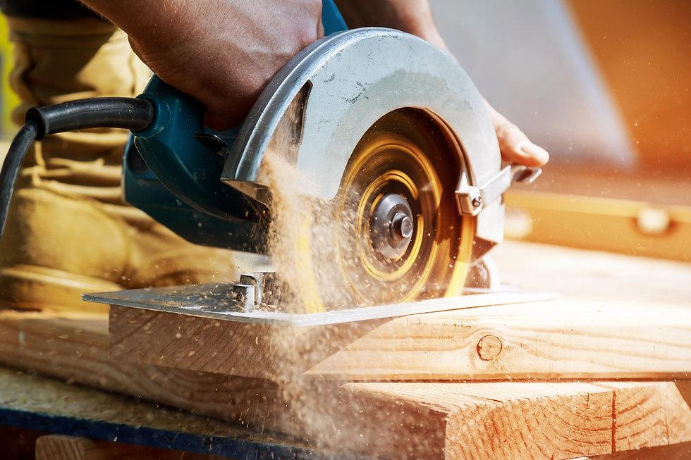 building-contractor-worker-using-hand-he