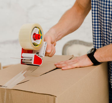 crop-man-packing-box-with-sticky-tape.jpg