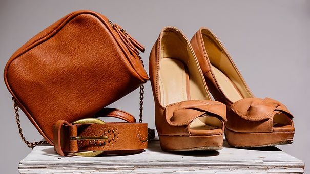 brown-female-bag-with-shoes-belt-isolate