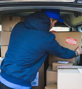 deliveryman-car-with-carton-boxes.jpg