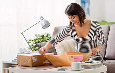 Lady opening parcel