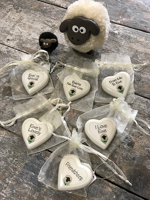 Pottery heart tokens in bag