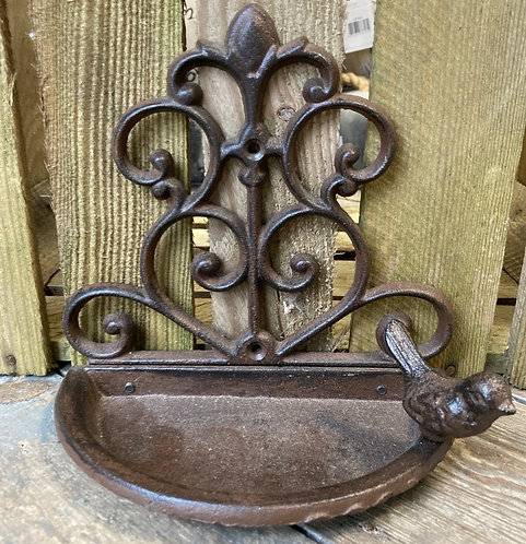 Cast iron bird feeder for wall fixing